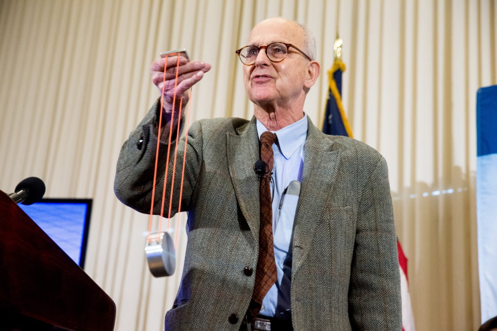 LIGO co-founder Rainer Weiss uses a visual aid as he speaks during a news conference Thursday at the National Press Club in Washington, D.C., announcing that scientists have finally detected gravitational waves, the ripples in the fabric of space and time that Einstein predicted a century ago.